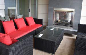 lounge-area-and-fireplace-near-pool-300x192